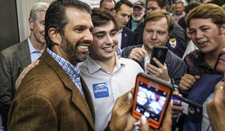 Donald Trump Jr., left, poses for a photo with Gus Morgan after speaking at the Good Ole Boys & Gals barbecue in Oxford, Miss. on Thursday, Oct. 24, 2019. Candidates for several state government races spoke at the event. Mississippians go to the polls on November 5. (Bruce Newman/The Oxford Eagle via AP)