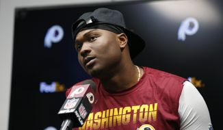 Washington Redskins quarterback Dwayne Haskins speaks during a news conference after an NFL football game against the Minnesota Vikings, Thursday, Oct. 24, 2019, in Minneapolis. The Vikings won 19-9. (AP Photo/Bruce Kluckhohn) ** FILE **
