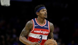Washington Wizards' Bradley Beal in action during a preseason NBA basketball game against the Philadelphia 76ers Friday, Oct. 18, 2019, in Philadelphia. (AP Photo/Matt Rourke) ** FILE **