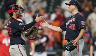 Washington Nationals catcher Kurt Suzuki and relief pitcher Javy Guerra celebrate after Game 2 of the baseball World Series against the Houston Astros Thursday, Oct. 24, 2019, in Houston. The Nationals won 12-3 to take a 2-0 lead in the series. (AP Photo/David J. Phillip) **FILE**