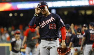 Washington Nationals left fielder Juan Soto celebrates after their win against the Houston Astros in Game 2 of the baseball World Series Thursday, Oct. 24, 2019, in Houston. The Nationals won 12-3 to take a 2-0 lead in the series. (AP Photo/Matt Slocum)