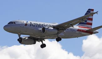 In this Oct. 18, 2019, photo an American Airline plane flies in to Salt Lake City International Airport in Salt Lake City. American Airlines, Inc. reports financial earns on Thursday, Oct. 24. (AP Photo/Rick Bowmer)
