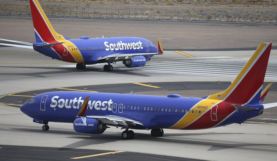 This July 17, 2019 photo shows Southwest Airlines planes at Phoenix Sky Harbor International Airport in Phoenix. Southwest Airlines Co. reports financial earns on Thursday, Oct. 24. (AP Photo/Ross D. Franklin, File)