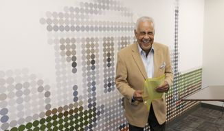 Former Virginia Gov. L Douglas Wilder smiles as he arrives for a news conference in Richmond, Va., Thursday, Oct. 24, 2019. Wilder made an announcement about being cleared of wrongdoing in his appeal of a sexual harassment accusation. (AP Photo/Steve Helber)