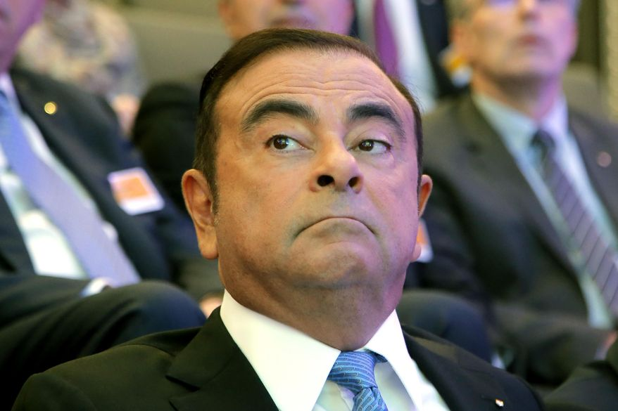 FILE - In this Oct. 6, 2017, file photo, former Nissan Motor chairman Carlos Ghosn attends a media conference outside Paris, France. Lawyers for Ghosn, who is awaiting trial in Japan, asked the Tokyo District Court on Thursday, Oct. 24, 2019 to dismiss all charges filed against him in his financial misconduct case. The papers his lawyers filed in the court last week allege prosecutorial misconduct will prevent Ghosn from having a fair trial. The fillings allege unlawful collusion between the prosecutors, government officials and executives at Nissan Motor Co. drummed up allegations of wrongdoing to remove him as chairman. (AP Photo/Michel Euler, File)