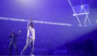 Kentucky coach John Calipari greets the crowd during the NCAA college basketball team's Big Blue Madness at Rupp Arena in Lexington, Ky., Friday, Oct. 11, 2019. (Alex Slitz/Lexington Herald-Leader via AP)
