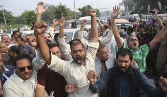 Supporters of Pakistani former Prime Minister Nawaz Sharif shout anti government slogans outside a hospital where Sharif admitted in Lahore, Pakistan, Thursday, Oct. 24, 2019. A Pakistani court is deciding whether to release Sharif, who was convicted on corruption charges, over concerns about his health. (AP Photo/K.M. Chaudary)