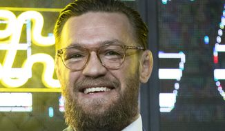 UFC (Ultimate Fighting Championship ) fighter Conor McGregor smiles during a news conference in Moscow, Russia, Thursday, Oct. 24, 2019. McGregor announced that he will fight an undisclosed opponent with the event expected to happen in Las Vegas, USA, in January 2020. (AP Photo/Pavel Golovkin)