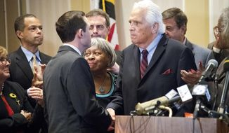 After announcing in Annapolis he is stepping down from his post, longtime Senate President Thomas V. Mike Miller, right, shakes hands with Baltimore Sen. Bill Ferguson, selected by Democrats to replace him, Thursday, Oct. 24, 2019 in Annapolis. (Joshua McKerrow/The Baltimore Sun via AP)