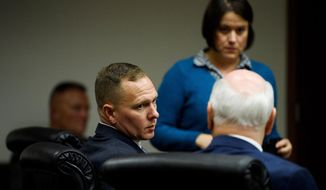 Suspended Greenville Sheriff Will Lewis speaks to his attorney, Rauch Wise, before court resumes on Thursday afternoon, Oct. 24, 2019, in Greenville, S.C. Lewis, 43, said he did not plan to have sex with his young female assistant at an out-of-town budget conference, but one thing led to another after they went out for drinks and ended up in her hotel room. (Josh Morgan/The Greenville News via AP, Pool)