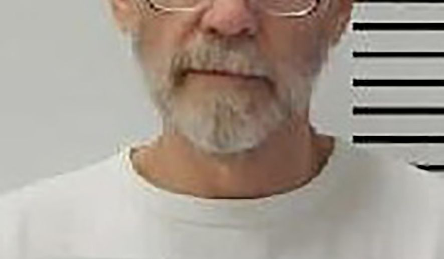 This Dec. 31, 2017 photo provided by the South Dakota Department of Corrections shows Charles Rhines at the South Dakota State Penitentiary in Sioux Falls. Rhines, a convict scheduled to be executed in November 2019 in South Dakota for a 1992 fatal stabbing is taking issue with the state's choice of the drug that will take his life. He is asking the state to follow the law on lethal injections at the time he was sentenced to death in 1993 when a protocol of an ultra-short-acting lethal drug and a chemical paralytic were used. Rhines was convicted of killing 22-year-old Donnivan Schaeffer while burglarizing a doughnut shop.(South Dakota Department of Corrections via AP)