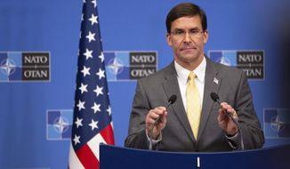 U.S. Secretary for Defense Mark Esper speaks during a media conference after a meeting of NATO defense ministers at NATO headquarters in Brussels, Friday, Oct. 25, 2019. NATO defense ministers on Friday discussed efforts to deter Russia in eastern Europe and the future of the mission training security forces in Afghanistan. (AP Photo/Virginia Mayo) **FILE**