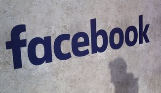 This Jan. 17, 2017, file photo shows a Facebook logo being displayed in a start-up companies gathering at Paris' Station F, in Paris. Facebook CEO Mark Zuckerberg plans to speak on Friday, Oct. 25, 2019, with new Corp CEO Robert Thomson. (AP Photo/Thibault Camus, File)