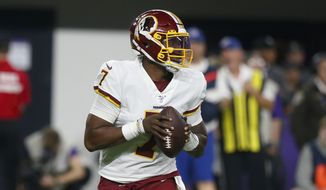 Washington Redskins quarterback Dwayne Haskins Jr. throws against the Minnesota Vikings during the first half of an NFL football game, Thursday, Oct. 24, 2019, in Minneapolis. (AP Photo/Jim Mone) **FILE**