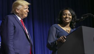 President Donald Trump looks at Tanesha Bannister, of Columbia, who spoke about how Trump's First Step program helped her get out of prison early at the David Swinton Campus Center, Friday, Oct. 25, 2019 at Benedict College in Columbia, S.C. (Tracy Glantz/The State via AP, Pool)