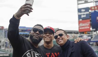 Alex Rodriguez and David Ortiz take a selfie with Washington Nationals' Juan Soto before Game 3 of the baseball World Series against the Houston Astros Friday, Oct. 25, 2019, in Washington. (AP Photo/Pablo Martinez Monsivais)