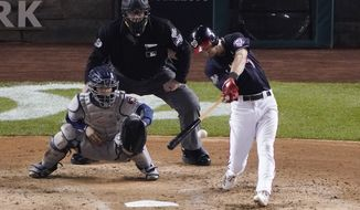 Washington Nationals' Trea Turner hits a single during the fourth inning of Game 3 of the baseball World Series against the Houston Astros Friday, Oct. 25, 2019, in Washington. (AP Photo/Alex Brandon) ** FILE **