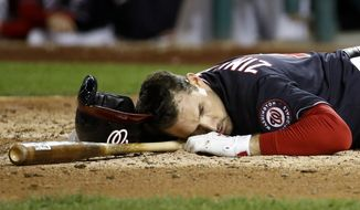 Washington Nationals' Ryan Zimmerman falls to the ground after nearly getting hit by a pitch during the fifth inning of Game 3 of the baseball World Series against the Houston Astros Friday, Oct. 25, 2019, in Washington. (AP Photo/Patrick Semansky) ** FILE **