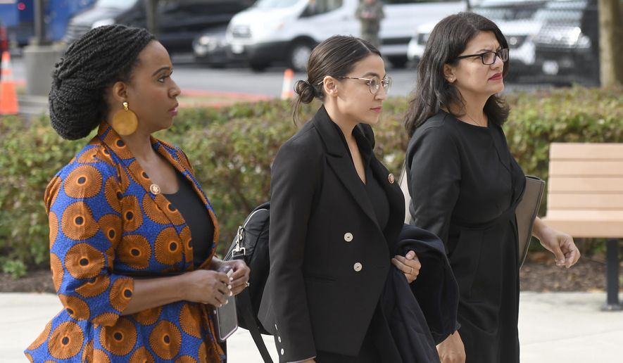 From left, Rep. Ayanna Pressley, D-Mass., Rep. Alexandria Ocasio-Cortez, D-N.Y., and Rep. Rashida Tlaib, D-Mich, arrive for the funeral service of Rep. Elijah Cummings at New Psalmist Baptist Church, Friday, Oct. 25, 2019, in Baltimore. The Maryland congressman and civil rights champion died Thursday, Oct. 17, at age 68 of complications from long-standing health issues. (AP Photo/Steve Ruark)