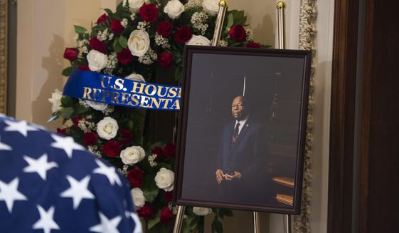 A portrait of the late Rep. Elijah Cummings, D-Md., sits nearby as his remains lie in state outside the House Chamber at the Capitol on Thursday, Oct. 24, 2019 in Washington. (Tom Williams/Pool via AP)