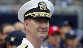 "FILE - In this file photo made Monday, July 4, 2016, Vice Admiral Walter E. ""Ted"" Carter, Superintendent of the U.S. Naval Academy, stands before throwing out a ceremonial first pitch before a baseball game between the Washington Nationals and the Milwaukee Brewers at Nationals Park, in Washington. The career military man and former superintendent of the U.S. Naval Academy was chosen Friday, Oct. 25, 2019, as the top candidate to become the next president of the University of Nebraska. (AP Photo/Alex Brandon)"