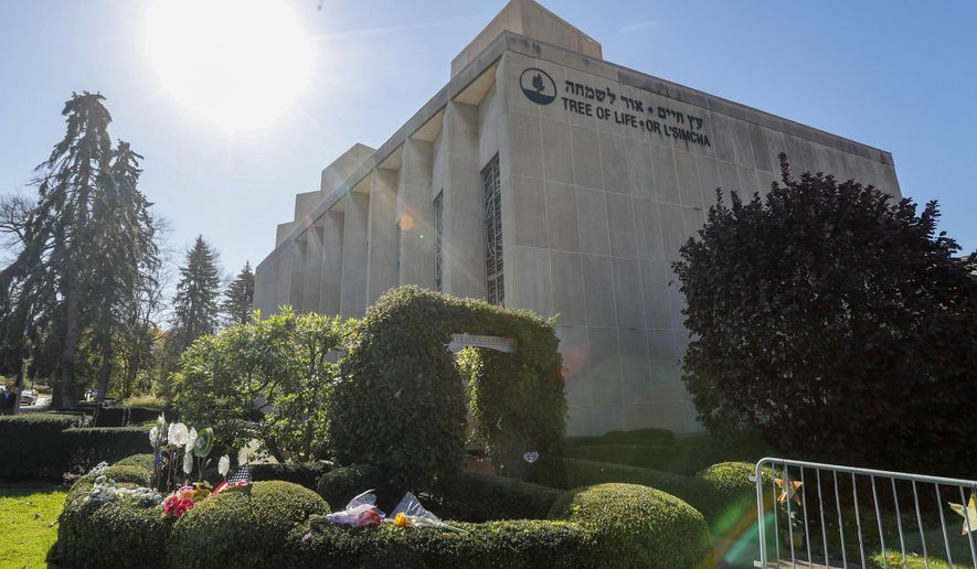 The sun shines over gardens surrounding the Tree of Life Synagogue Thursday, Oct. 24, 2019 in the Squirrel Hill neighborhood of Pittsburgh. Sunday, Oct. 27, marks the one-year anniversary of the deadliest attack on Jews in U.S. history. A virtual remembrance, an overseas concert and community service projects highlight the many plans for commemorating the loss. (AP Photo/Keith Srakocic)