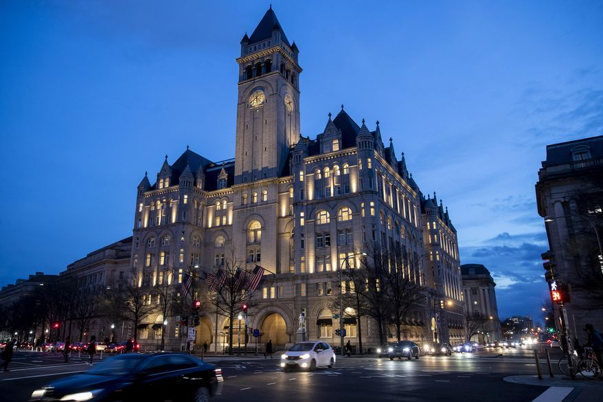 In this Jan. 23, 2019, file photo, the Trump International Hotel near sunset in Washington. A federal appeals court will reconsider a ruling from a three-judge panel that threw out a lawsuit accusing President Donald Trump of illegally profiting off the presidency through his luxury Washington hotel. The Richmond-based 4th U.S. Circuit Court of Appeals agreed Tuesday, Oct. 15, to hold a hearing before the full court of 15 judges. Arguments are scheduled for Dec. 12. (AP Photo/Alex Brandon, File)