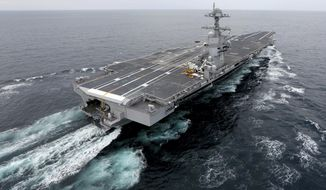 The aircraft carrier Gerald R. Ford. The nation's newest aircraft carrier has headed out to sea for more tests after it underwent a series of upgrades and fixes at a Virginia shipyard. (Steve Earley/The Virginian-Pilot via AP, File) **FILE**