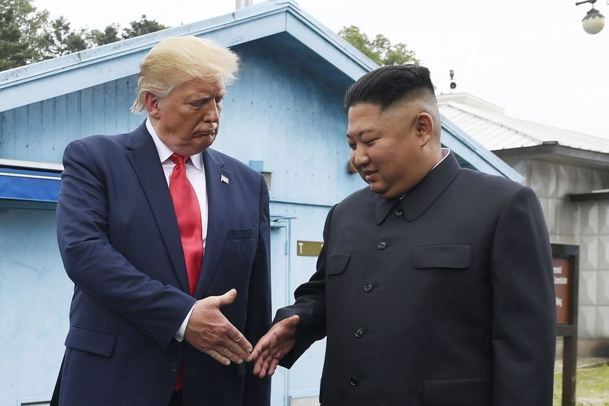 In this June 30, 2019, file photo, North Korean leader Kim Jong-un, right, and U.S. President Donald Trump prepare to shake hands at the border village of Panmunjom in the Demilitarized Zone, South Korea. North Korea said it's running out of patience with the United States over what it described as hostile policies and unilateral disarmament demands. It's warning that a close personal relationship between their leaders alone wouldn't be enough to prevent nuclear diplomacy from derailing. (AP Photo/Susan Walsh, File)