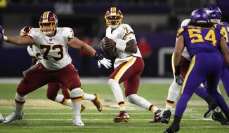 Washington Redskins quarterback Dwayne Haskins (7) looks to throw a pass against the Minnesota Vikings during an NFL football game, Thursday, Oct. 24, 2019, in Minneapolis. (Jeff Haynes/AP Images for Panini)