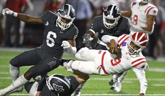 Mater Dei quarterback Bryce Young is tackled after scrambling out of the pocket during a high school football game against St. John Bosco in Bellflower, Calif., Friday, Oct. 25, 2019. (Scott Varley/The Orange County Register via AP) ** FILE **