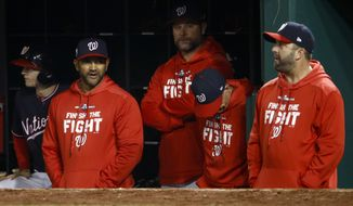 Members of the Washington Nationals watch during the seventh inning of Game 4 of the baseball World Series against the Houston Astros Saturday, Oct. 26, 2019, in Washington. (AP Photo/Patrick Semansky)