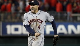 Houston Astros right fielder George Springer celebrates their teams win against the Washington Nationals in Game 3 of the baseball World Series Saturday, Oct. 26, 2019, in Washington. The Astros won 4-1. (AP Photo/Jeff Roberson) ** FILE **