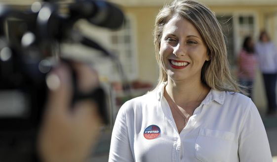"""In this Nov. 6, 2018, file photo, Katie Hill, then a Democratic Party candidate from California's 25th Congressional district, talks to a reporter after voting in her hometown of Agua Dulce, Calif. She won the election, flipping a traditional GOP stronghold. Now, U.S. Rep. Hill, D-Calif., has apologized to friends and supporters for engaging in an inappropriate affair with a campaign staffer, but she still let down Susan Slates, a fellow Democrat, who said she was """"disappointed,"""" but quickly jumped to Hill's defense, saying anything she did pales in comparison to what's she's witnessed under President Donald Trump. (AP Photo/Marcio Jose Sanchez, File)"""