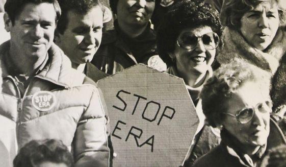 FILE -  In this Feb. 2, 1982 file photo, opponents of the Equal Rights Amendment listen to speakers during a demonstration at the Capitol in Richmond, Va. Advocates of the Equal Rights Amendment are mounting a tremendous effort to elect supporters of the long-stalled gender equality measure next month in Virginia's elections. (AP Photo/Steve Helber)