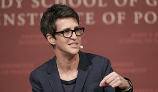 "FILE - In this Oct. 16, 2017 file photo, MSNBC television anchor Rachel Maddow, host of the Rachel Maddow Show, moderates a panel at a forum called ""Perspectives on National Security,"" at the John F. Kennedy School of Government, at Harvard University, in Cambridge, Mass. Time's Up has called on NBC Universal to release all former employees from non-disclosure agreements that might be impinging on their ability to speak out about sexual harassment, and also to hold an independent investigation into workplace culture at NBC. The organization said NBC didn't go far enough with its statement, first reported Friday, Oct. 25, 2019, by Maddow, that employees should contact the company in order to be released from any ""perceived obligation"" to remain quiet. (AP Photo/Steven Senne, File)"
