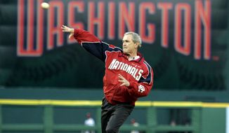 FILE - In this April 14, 2005, file photo, President George W. Bush throws out the ceremonial first pitch at the Washington Nationals home opener in Washington. The Nationals play the Arizona Diamondbacks in the first regular season baseball game in Washington in 34 years. (AP Photo/Evan Vucci) ** FILE **