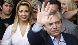 "Alberto Fernandez, presidential candidates for the ""Frente para Todos"" coalition, waves after voting in Buenos Aires, Argentina, Sunday, Oct. 27, 2019. (AP Photo/Natacha Pisarenko)"