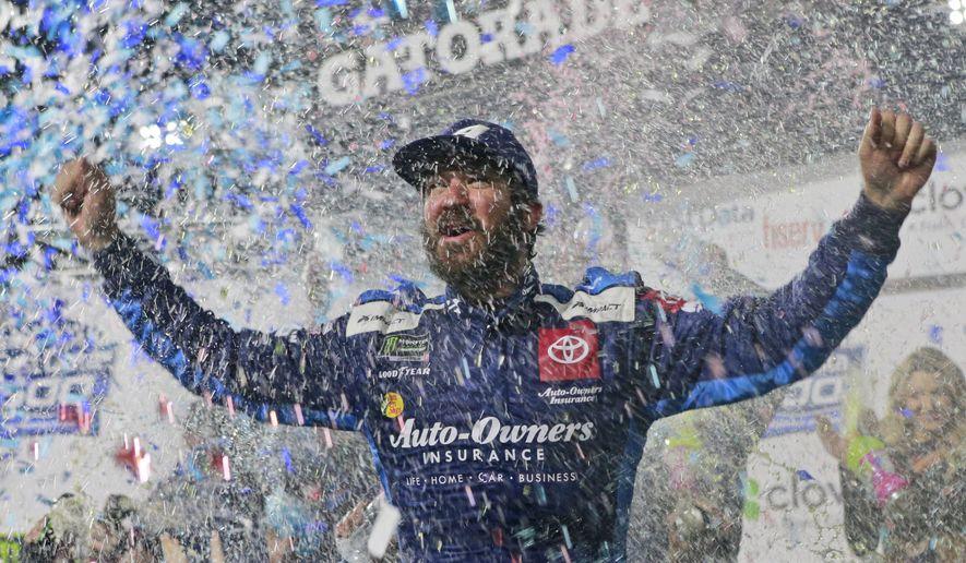 Martin Truex Jr. celebrates after winning a NASCAR Cup Series race at Martinsville Speedway in Martinsville, Va., Sunday, Oct. 27, 2019. (AP Photo/Steve Helber)