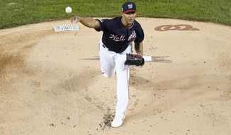Washington Nationals starting pitcher Joe Ross throws during the first inning of Game 5 of the baseball World Series against the Houston Astros Sunday, Oct. 27, 2019, in Washington. (AP Photo/Pablo Martinez Monsivais)