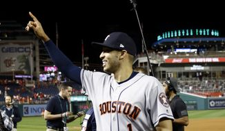 Houston Astros shortstop Carlos Correa walks off the field after Game 5 of the baseball World Series Washington Nationals Sunday, Oct. 27, 2019, in Washington. The Astros won 7-1 to take a 3-2 lead in the series. (AP Photo/Patrick Semansky) **FILE**