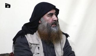 This file image made from video posted on a militant website April 29, 2019, purports to show the leader of the Islamic State group, Abu Bakr al-Baghdadi, being interviewed by his group's Al-Furqan media outlet. (Al-Furqan media via AP, File)