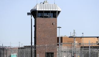 This Friday, Oct. 25, 2019, photo shows a guard tower at the Nebraska State Penitentiary, in Lincoln, Neb. Nebraska officials are making an aggressive new push to remove contraband from the state's largest prisons, but the task is more difficult than it seems. Nebraska's crackdown is the latest example of states trying to clamp down on drugs, weapons and cellphones. (AP Photo/Nati Harnik)