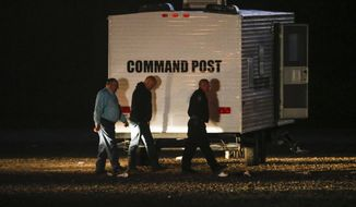 Hunt County Sheriff Randy Meeks, left, arrives at a the scene after a shooting in Greenville, Texas, on Sunday, Oct. 27, 2019. A gunman opened deadly fire at an off-campus Texas A&M University-Commerce party, that left over a dozen injured before he escaped in the ensuing chaos, a sheriff said Sunday. (Ryan Michalesko/The Dallas Morning News via AP)