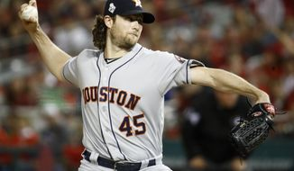 Houston Astros starting pitcher Gerrit Cole throws against the Washington Nationals during the first inning of Game 5 of the baseball World Series Sunday, Oct. 27, 2019, in Washington. (AP Photo/Patrick Semansky)