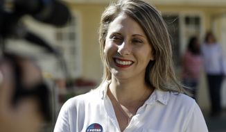 """In this Nov. 6, 2018, photo, Katie Hill speaks during an interview after voting in Agua Dulce, Calif.  Hill announced her resignation over the weekend following the publication of explicit photos that outed the relationship. She describes the photos as """"revenge porn"""" and is vowing to fight the problem so that women and girls don't shy away from politics in the future. Hill's resignation in a sex scandal she blamed on an abusive husband has observers wondering if women are held to higher standards in public life and what the future holds for politicians coming of age in the iPhone era. (AP Photo/Marcio Jose Sanchez) **FILE**"""