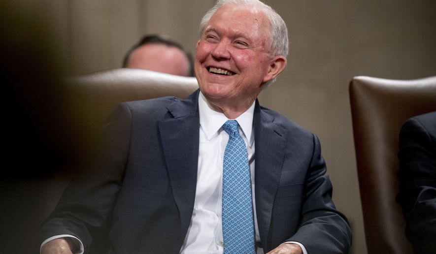 In this May 9, 2109, file photo, former Attorney General Jeff Sessions smiles during a farewell ceremony for Deputy Attorney General Rod Rosenstein in the Great Hall at the Department of Justice in Washington. (AP Photo/Andrew Harnik, File)