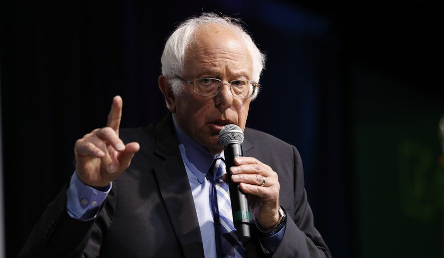 "Democratic presidential candidate Sen. Bernie Sanders, I-Vt., speaks at the J Street National Conference, with the hosts of ""Pod Save the World,"" Tommy Vietor, left, and Ben Rhodes, Monday, Oct. 28, 2019, in Washington. (AP Photo/Jacquelyn Martin)"