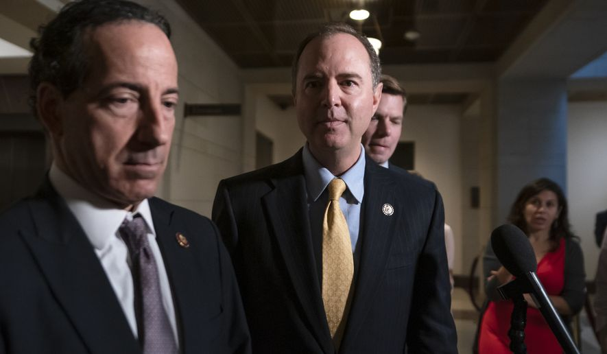 From left, Rep. Jamie Raskin, D-Md., House Intelligence Committee Chairman Adam Schiff, D-Calif., and Rep. Eric Swalwell, D-Calif., return to a secure area at the Capitol after informing reporters that former deputy national security adviser Charles Kupperman failed to appear to be interviewed in the impeachment inquiry of President Donald Trump, in Washington, Monday, Oct. 28, 2019. House Democrats are trying to determine if Trump violated his oath of office by asking a foreign country, Ukraine, to investigate his political opponent, former Vice President Joe Biden, and his son Hunter Biden. (AP Photo/J. Scott Applewhite)