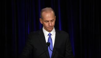 In this April 29, 2019, file pool photo Boeing Chief Executive Dennis Muilenburg speaks at a news conference after company's annual shareholders meeting at the Field Museum in Chicago. (Joshua Lott/The Washington Post via AP, Pool, File)